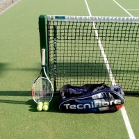 Racquet and balls
